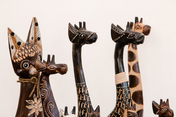 wooden figurines Animal Animal Representation Antique Art And Craft Carving - Craft Product Close-up Craft Creativity Design Indoors  Man Made Metal No People Ornate Representation Sculpture Statue Still Life Studio Shot Wall - Building Feature White Background Wood - Material
