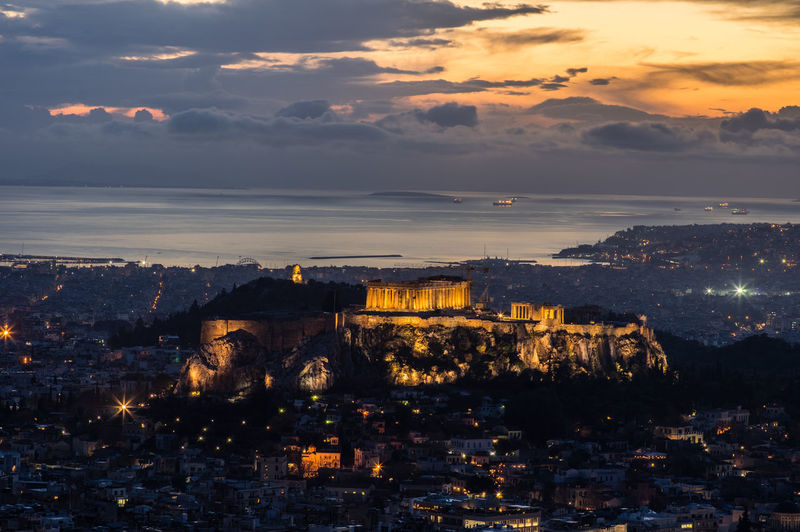 Acropolis at sunset Acropolis, Athens Ancient Sunset_collection Acropolis Architecture Athens Beauty In Nature Building Exterior Built Structure City Cityscape Cloud - Sky Day Greece Illuminated Nature No People Outdoors Scenics Sky Sunset Travel Destinations