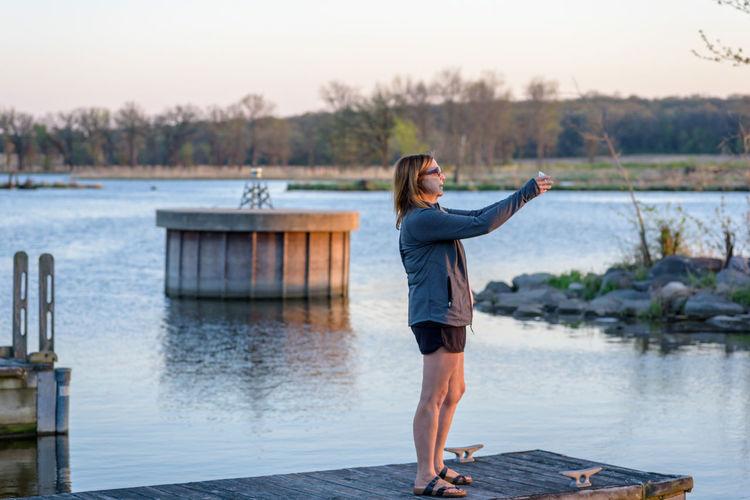 Full length of man standing on lake against sky