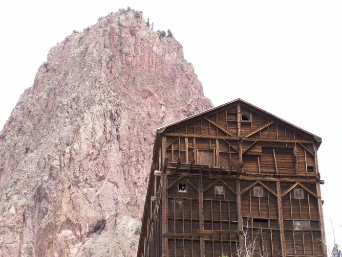 Old wooden mining structure Ancient Civilization Architecture Building Exterior Built Structure Clear Sky Creede, CO Culture Day Historic History House Hut Mining Mountain Outdoors River Roof Ruined Tree Water Wood Wooden