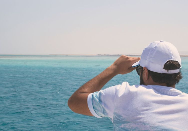 EyeEm Selects Sea Water Horizon Over Water One Person Real People Clear Sky Leisure Activity Scenics Outdoors Beauty In Nature Nature Lifestyles Standing Sky Day Men Beach Nautical Vessel Young Adult People Breathing Space EyeEm Ready