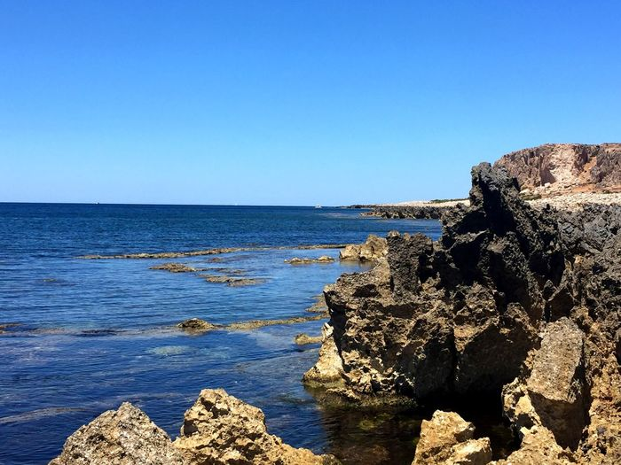 Sea Rock - Object Nature Clear Sky Beauty In Nature Blue Scenics Tranquil Scene Water Outdoors Day Tranquility Italy Travel Summer Sunlight No People Rock