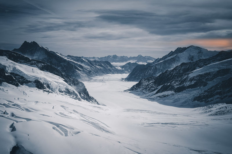 "The Aletsch glacier (Aletschgletscher) in the Swiss Alps, Bernes Highlands, Jungfrau region, of the last big glaciers in the Alps and a popular travel destination for tourists from all over the world, which is a threat for the glacier at the same there by train was an abivalent experience. I was stunned by the beauty of nature and felt bad for being one of a million humans threatening it by travelling taken from Jungfraujoch, ""Top of Europe"". Alpen Alpine Gletscher Hiking Schweiz Travel Aletsch Aletschgletscher Alpine Landscape Alps Beauty In Nature Cold Cold Temperature Glacier Glaciers Nature Outdoor Photography Outdoors Snow Snowcapped Mountain Swiss Alps Swiss Mountains Switzerland Switzerlandpictures Winter The Great Outdoors - 2018 EyeEm Awards"