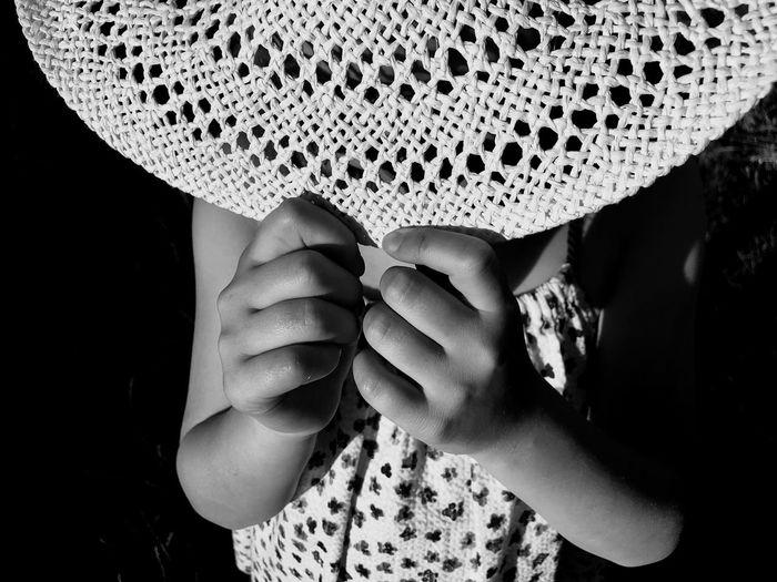 Girl holding hat in darkroom