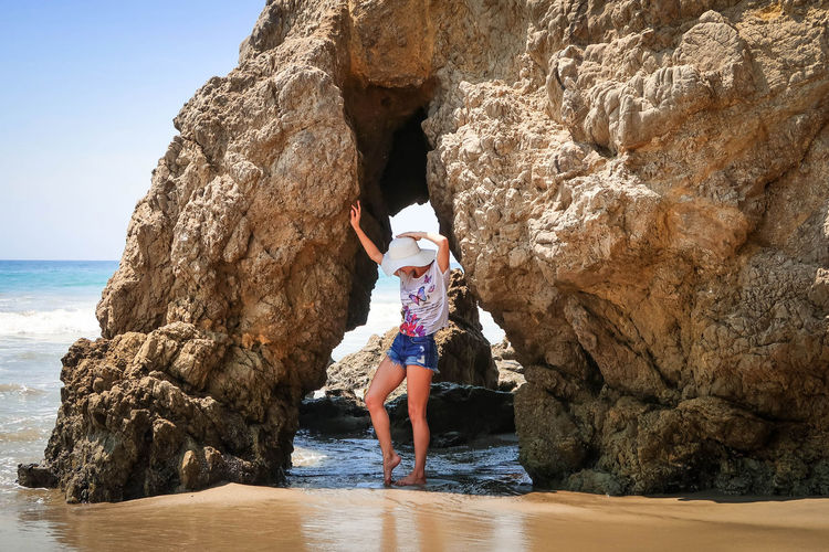 Girl on the beach Travel Beauty In Nature Cliff Day Destination Girl Horizon Over Water Leisure Activity Lifestyles Model Motion Nature One Person Outdoors Real People Rock - Object Rock Formation Sea Vacation Water Young Adult Young Women