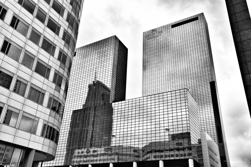 Reflections of Rotterdam. Architecture Skyscraper Building Exterior Low Angle View Built Structure Modern Tower City Outdoors Office Park Travel Travel Photography Blackandwhite Black And White Photography Rotterdam Architecture Black And White Collection  Modern City Rotterdam Architecture Low Angle View Window