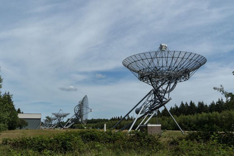 Radio telescopes against sky