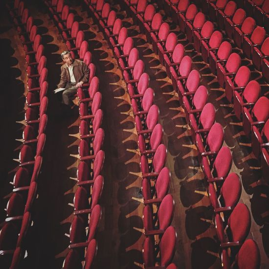 Are they coming? Theater Red Alone Man Waiting Chair Looking Back Play Theatre Chair Light Pattern From Above  Telling Stories Differently