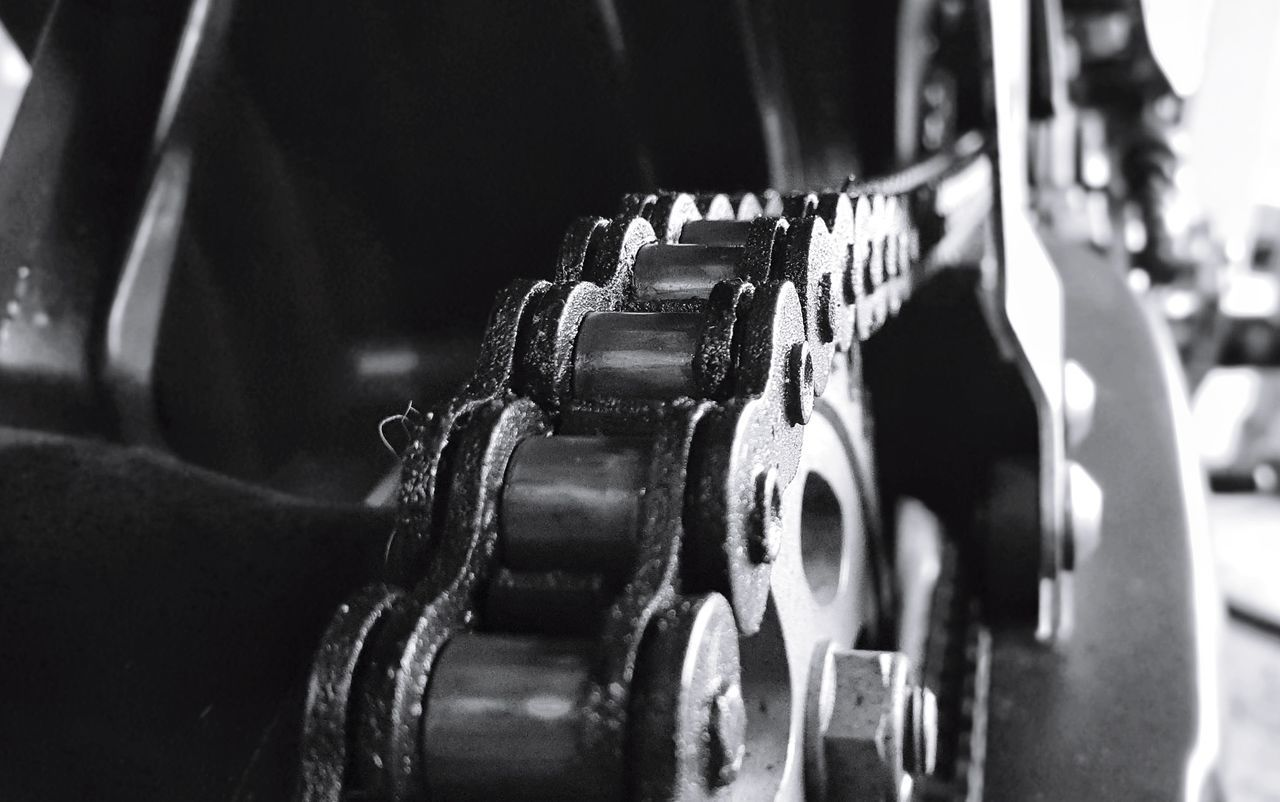 CLOSE-UP OF MACHINE PART IN ROW