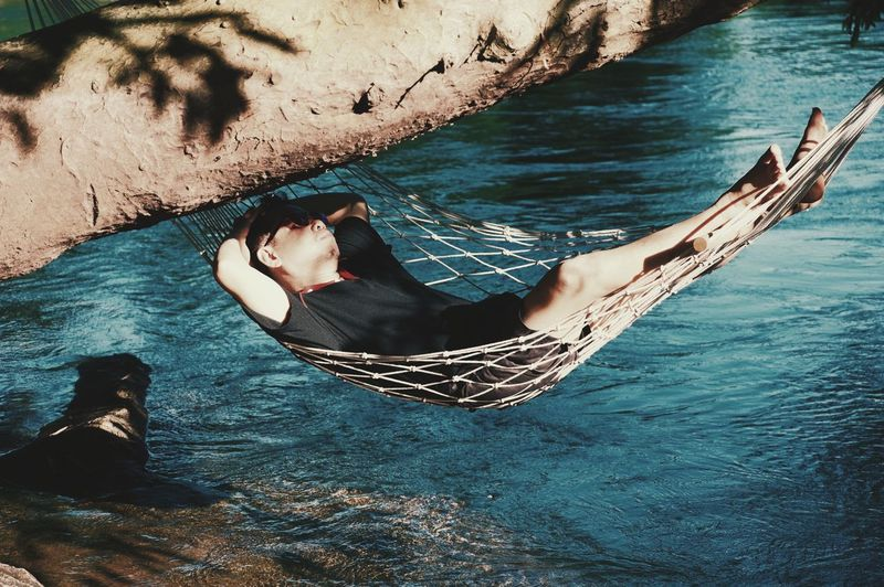 High angle view of woman relaxing on boat in sea