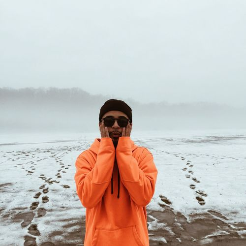 Cold Temperature Winter Nature Warm Clothing Real People One Person Lifestyles Outdoors Standing Leisure Activity Sunglasses Sky Front View Day Snow Beauty In Nature Men Young Adult Scenics Landscape Snow ❄ Snow Day FootPrint Orange Color Orange