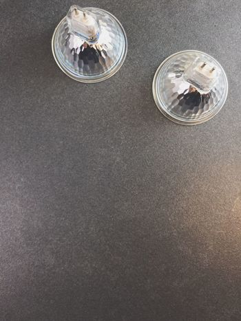 halogen lamps Gray Background Silver Colored Drinking Glass High Angle View Studio Shot Business Directly Above Silver - Metal Small Group Of Objects No People Indoors  Aluminum Close-up Day Halogen Lamps Halogen Bulb Lights Top Perspective Common Objects Minimalism