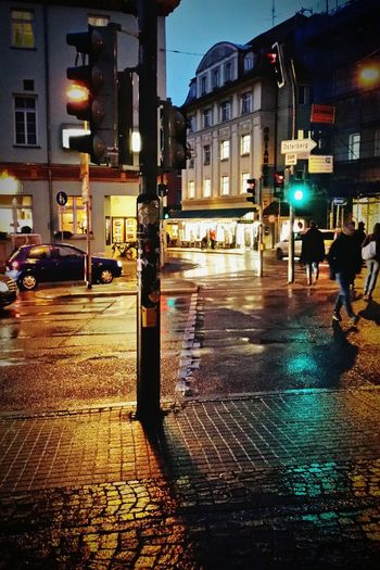 walking through a rainy thursday Street People Tübingen Eye4photography  EyeEmBestPics EyeEm Best Shots Taking Photos Reflections Rain Rainy Day Car Lights Street Lights Streetphotography Traffic Traffic Lights 43 Golden Moments Uncomfortable Rainy Street Reflections Wet Cities At Night Road Here Belongs To Me The Street Photographer - 2016 EyeEm Awards