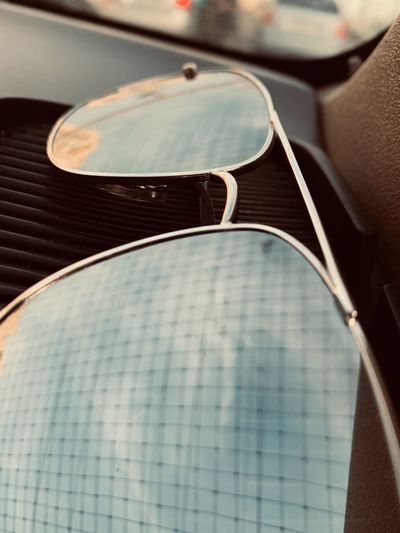 High angle view of sunglasses in car