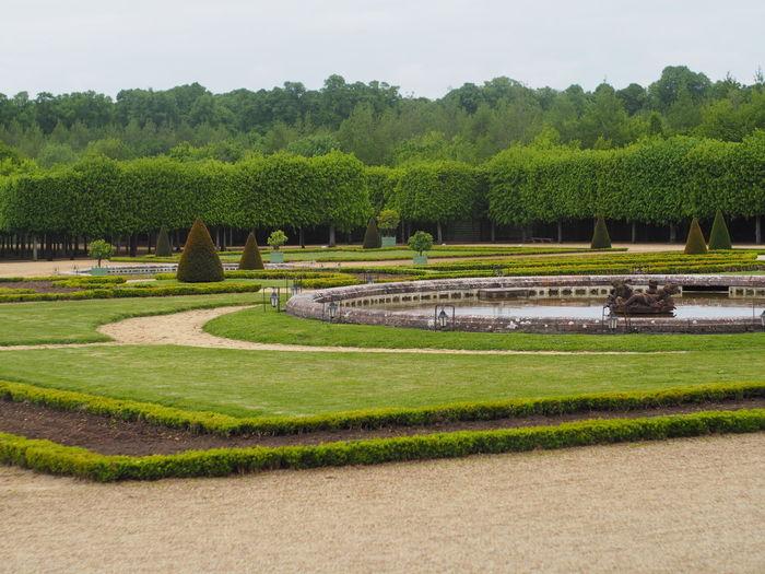 Scenic view of formal garden against sky