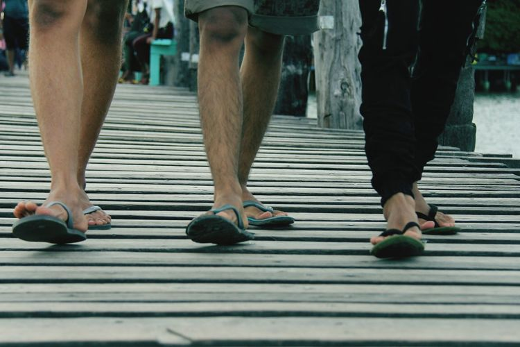 Low Section Of People Walking On Boardwalk