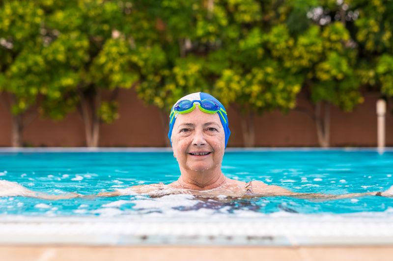 Portrait of senior woman in swimming pool