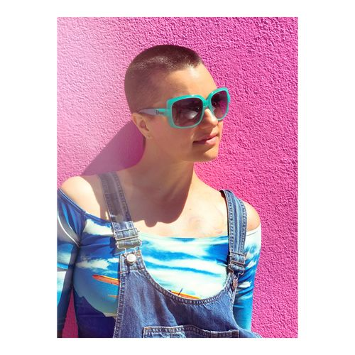 Playing by her own rules..... Sunglasses Casual Clothing Leisure Activity One Person Outdoors Day Beautiful Woman Adult Androgynous Girl Shaved Head Pink Wall Edgylook Woman Close-up Lifestyles Lifestyle Los Angeles Life One Woman Only Androgyny Streetphotography