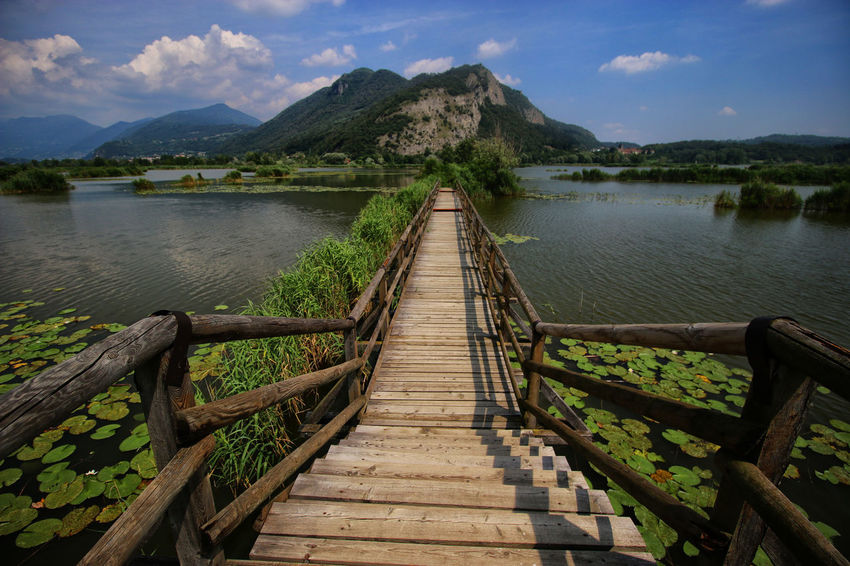 Clouds Nuvole Tranquil Scene Paesaggioitaliano Paesaggi_ditalia Torbiere Torbieredelsebino Landscape_photography Landcsape Paesaggio No People Beauty In Nature Riflessosullacqua Water Greeen Ninfea Water Lily Mountains Mountain Cloud - Sky Bridge