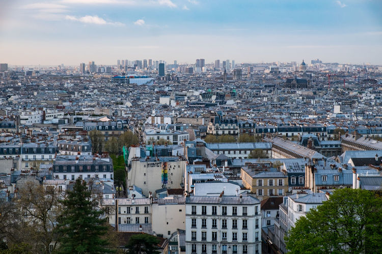 High angle view of paris in the morning against sky.