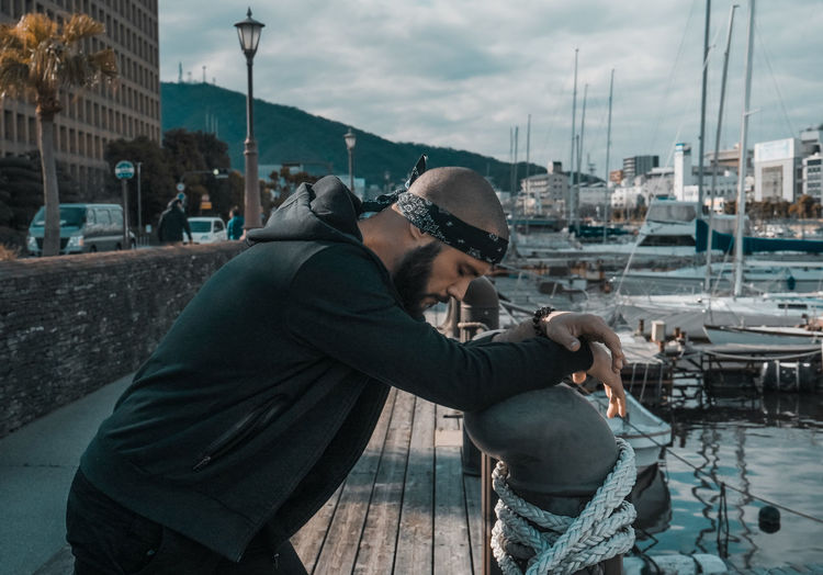 // shooting with Pedro // EyeEm My Best Photo portrait of a friend Portugal One Person Real People Men Side View Building Exterior Three Quarter Length Architecture Day Lifestyles Transportation City Built Structure Adult Nature Nautical Vessel Clothing Young Adult Sky Outdoors Sad Give Up