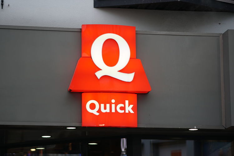 Brussels, Belgium - December 9, 2017: Quick Restaurant signboard. Quick Restaurants is an originally Belgian chain of hamburger fast food restaurants, the first hamburger chain Belgique Belgium Brussels Bruxelles Building Exterior Chain Close-up Fast Food Restaurant Hamburger No People Outdoors Quick Restaurant Retaurant
