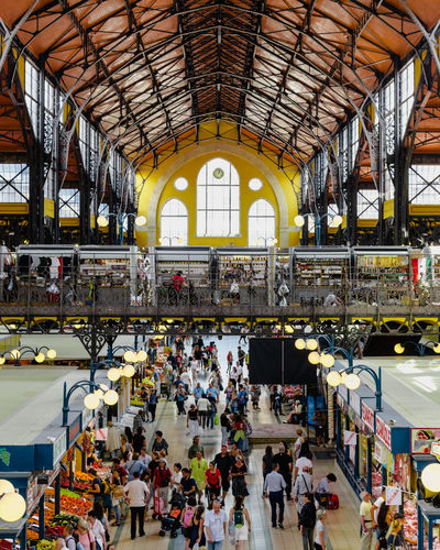 Budapest Hungary Market Market Hall Adult Arch Architecture Built Structure Ceiling Crowd Day Group Of People Indoors  Large Group Of People Lifestyles Marketplace Men Railroad Station Real People Skylight Station Tourism Transportation Travel Women