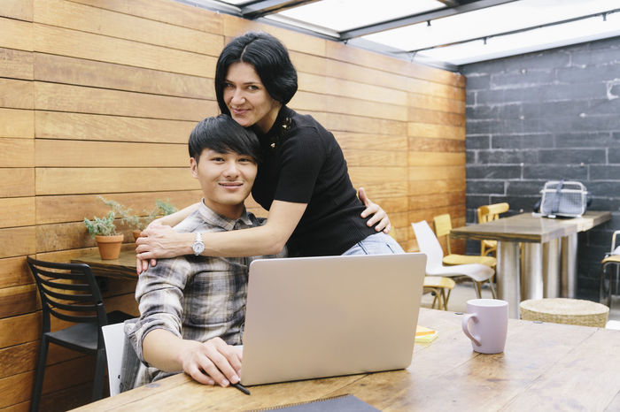Couple Coworking Office Small Business Boyfriend Casual Clothing Chinese Coffee - Drink Cup Of Coffee Friendship Girlfriend Laptop Lifestyles Mid Adult Men Mid Adult Women Multiethnic Couple Partners Small Company Startup Technology Togetherness Two People Using Laptop Wireless Technology