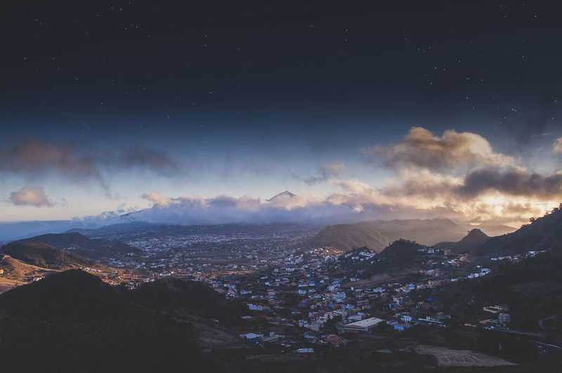 Aerial view of city against sky at night tenerife