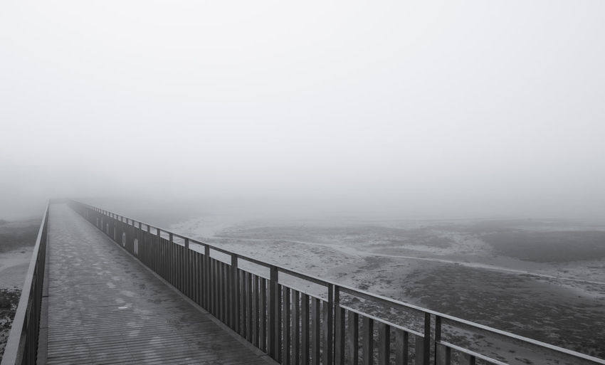 Into The Void Beach Beauty In Nature Day Fog Horizon Over Water Idyllic Nature No People Outdoors Railing Scenics Sea Sky Tranquil Scene Tranquility Water