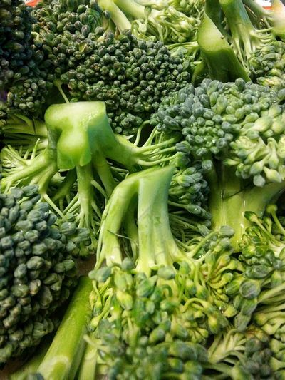 Close-up of broccolis for sale at market stall