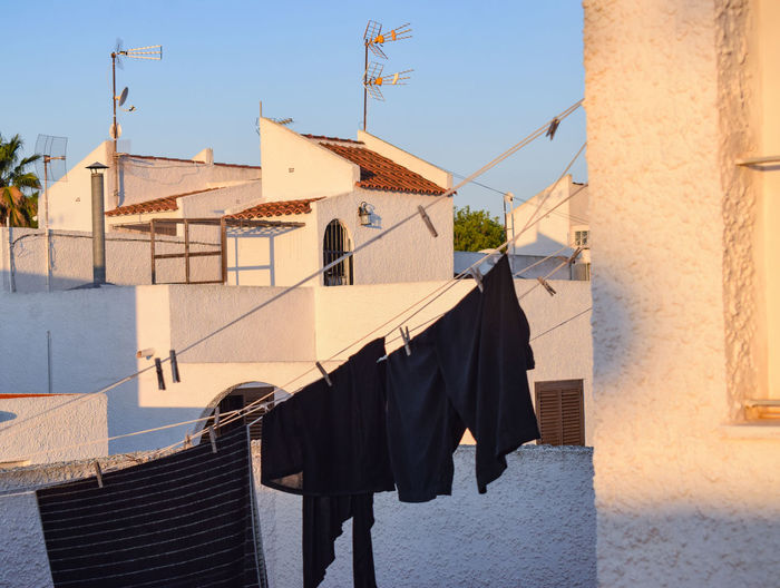 Clothes drying on roof against buildings in town