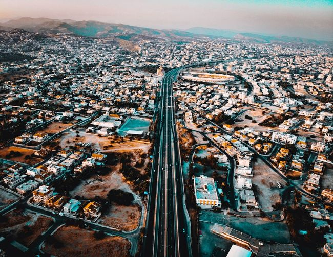 Ride the Highway Urbanana: The Urban Playground Dji Air Mavic Above View Blue Limassol Road House Building Road Highway Urban EyeEmNewHere City Cityscape Water Aerial View High Angle View Sky Landscape Two Lane Highway Dividing Line Vehicle High Street Road Marking Asphalt Office Building