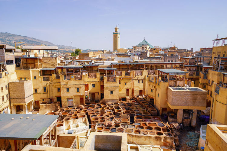 One of many Fes tanneries Travel Destinations Travel Photography Digital Nomad EyeEmNewHere Morocco Fes Morocco Architecture Built Structure Building Exterior Sky Building City Day Clear Sky Nature No People High Angle View Sunlight Town Residential District Outdoors Religion Travel Place Of Worship Belief