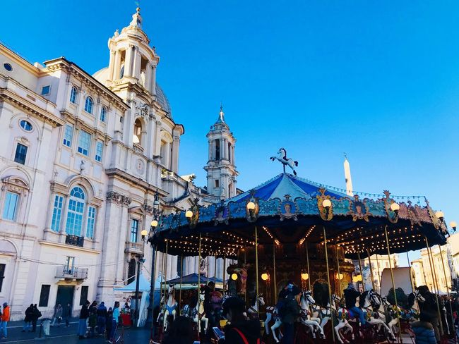 Large Group Of People Architecture Building Exterior Built Structure Real People Men Women Religion Crowd Spirituality Blue Lifestyles Leisure Activity Clear Sky Place Of Worship Outdoors Sky Travel Destinations Day City Rome, Italy Roma PiazzaNavona Thegreatbeauty Carousel