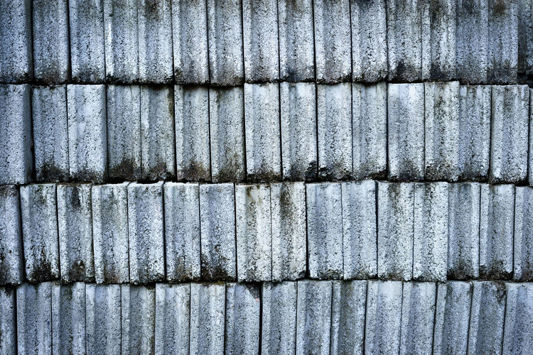 Architecture Backgrounds Barrier Boundary Close-up Corrugated Day Fence Full Frame In A Row Iron Metal No People Outdoors Pattern Repetition Textured  Wall - Building Feature Weathered Wood - Material