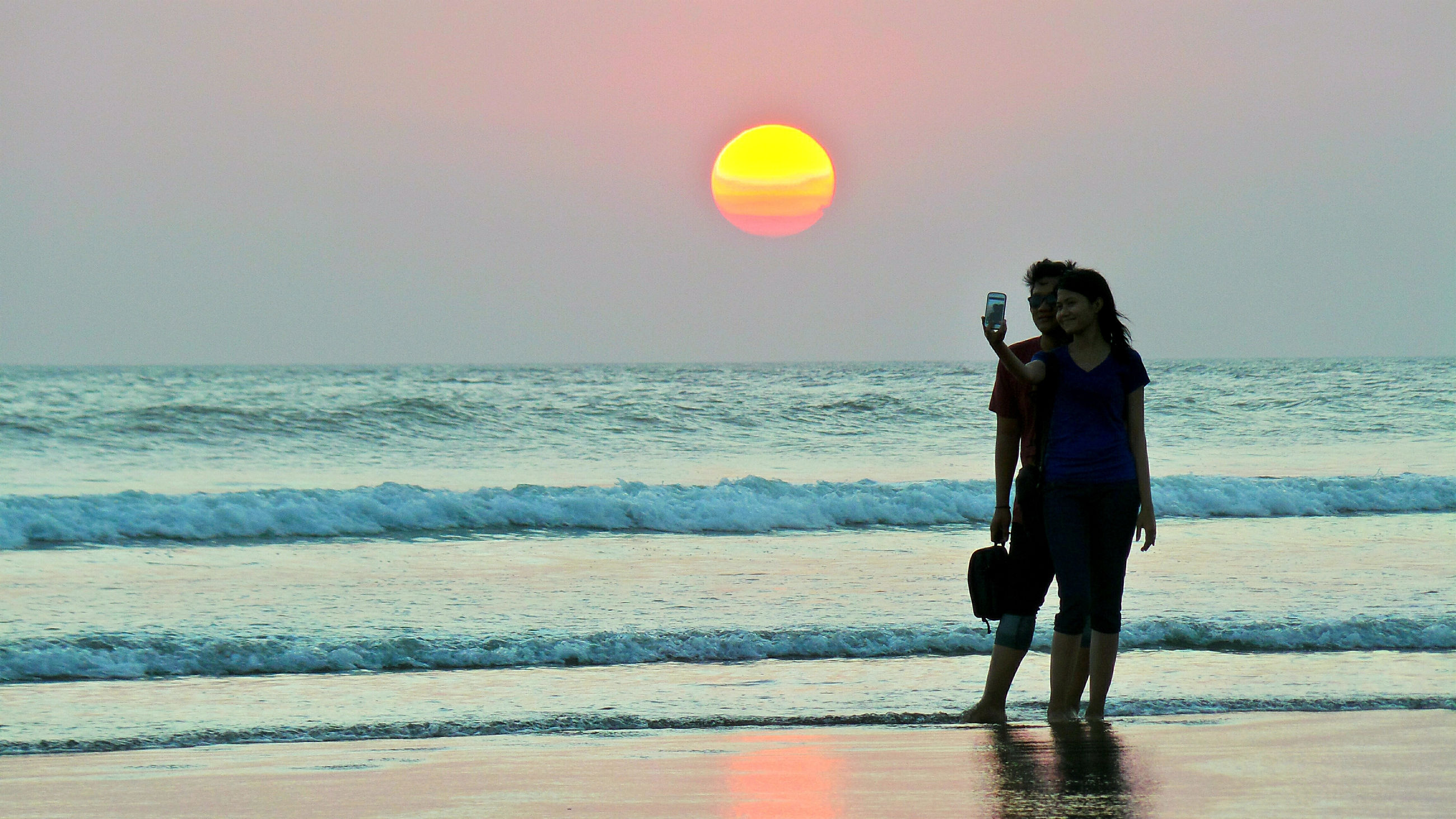 sea, water, beach, horizon, horizon over water, sky, two people, beauty in nature, leisure activity, sunset, real people, land, full length, standing, scenics - nature, wave, women, lifestyles, nature, couple - relationship, outdoors