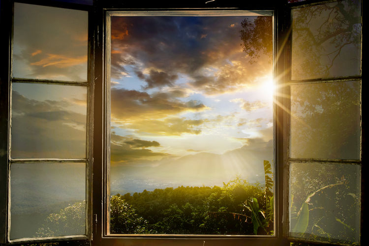 Sky Window Sunlight Sun Cloud - Sky Sunbeam Lens Flare Sunset Nature Beauty In Nature Glass - Material Plant Transparent No People Tree Tranquility Tranquil Scene Outdoors Day Bright Streaming หน้าต่าง