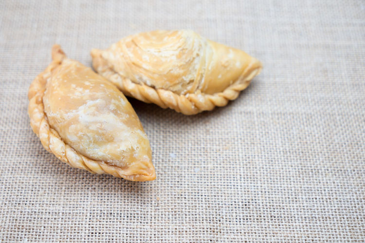 Curry Puff with copy space on table Crust Wheat Fresh Dinner ASIA Asian  Background Bake Bakery Bread Breakfast Brown Cafe Chicken Cook  Cooking Cuisine Culture Curry Delicious Dessert Flour Food Fried Gourmet Hot Isolated Light Malay Malaysian Meal Morning Pastry Pie Plate Puff Puffs Samosa Shape Snack Spicy Sweet Table Tasty Traditional View White Wooden Yummy Food And Drink