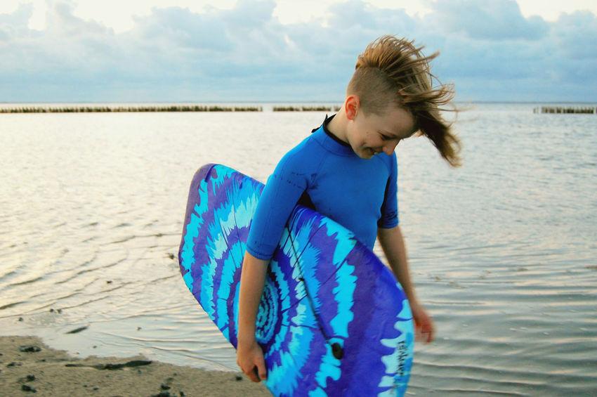 Northsea Coast Bodyboard Wetsuit Surfboy Seaside EyeEmNewHere Surfwear Sea Water Beach Blue Sand Sky Horizon Over Water Tousled Hair Surfer Surfing Water Sport Surfboard Summer Exploratorium