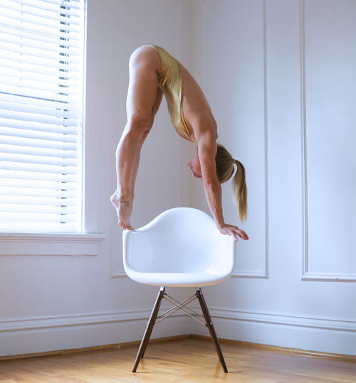Woman stretching on chair