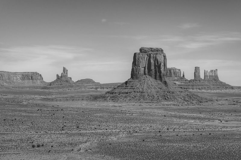 Black and white landscape of monoliths in Monument Valley Rock Spires Monument Valley Tribal Park Black And White Sky Cloud - Sky Nature Land Outdoors Landscape Travel Destinations Scenics - Nature Day No People Environment Tranquil Scene Beauty In Nature Tranquility Travel