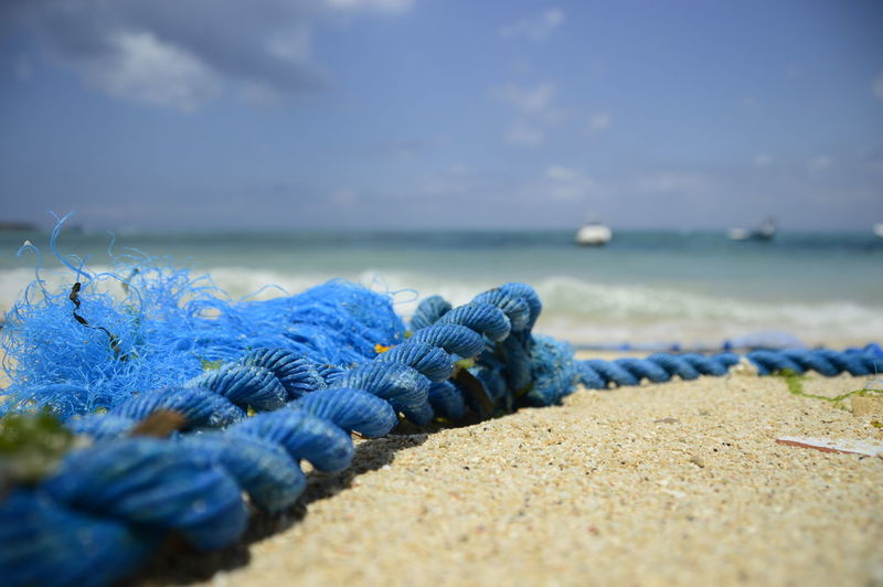 Close-up of rope on shore at beach
