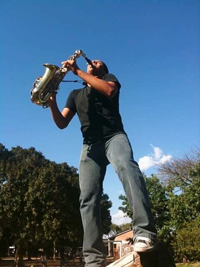 Musical Instrument Music One Man Only Musician Adult One Person Tree Only Men People Saxophone Adults Only Men Sky Performance Outdoors Full Length Day Young Adult Jazz Music Live For The Story