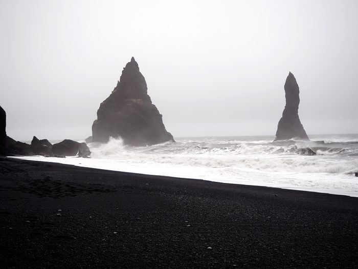 Iceland Volcanic  Black Sand Beach Volcanic Landscape Sea Water Beach Land Rock Sky Rock Formation Solid Rock - Object Beauty In Nature Scenics - Nature Motion Wave Nature Tranquil Scene Horizon Over Water No People Tranquility Stack Rock