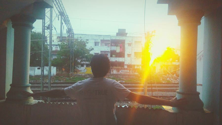Streched out to feel Streched Arms Luminous Railway Track Sunset Sunbeam Sunlight Back Lit Lens Flare One Person Rear View Adult Sun People Skyscraper Day Outdoors City Cityscape Pixelated EyeEmNewHere