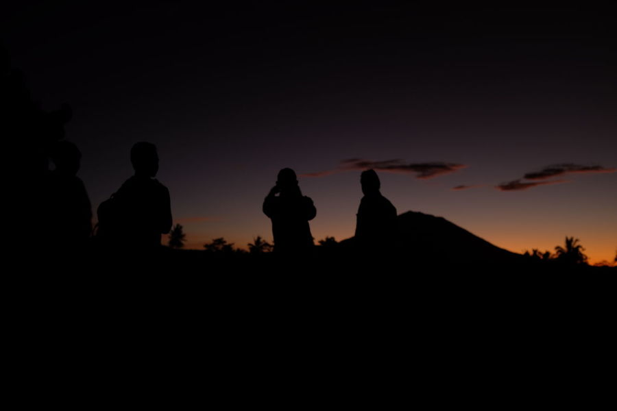 a group of photographers wait for the sun to rise behind the holiest volcano in Bali, Mt Agung. when we were waiting for the sun, it was as if time stood still--as if we were all in meditation with Mt Agung. the death of night gives way to the birth of a new day in Bali. i was amazed to see the resulting images. this one was my favourite because of the mysterious silhouettes, the natural vignette framing, and the play of contrasts and subtle colour tones. most of my followers probably know by now that i prefer monochrome street photography. so this shot is quite different for me. no edit/filter/post processing. Bali, Indonesia Copy Space Dawn Feel The Journey Landscape Landscape_Collection Mount Agung Negative Space Orange Color Silhouette Sky Sunrise Tourism Tranquil Scene Unrecognizable Person Volcano Wanderlust Showcase June Dawn Patrol Exotic Destination Puffy Clouds Fine Art Photography People And Places Bali Epic Sunrise