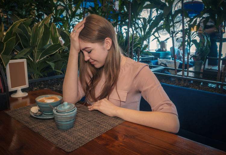 Young woman at cafe