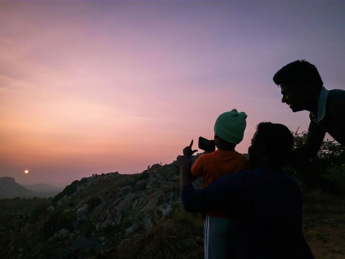 Two people teaching a kid how to take photograph. Live For The Story Silhouette Sky Nature Beauty In Nature Bonding Outdoors Scenics Mountain Hiking Child Youngphotographer