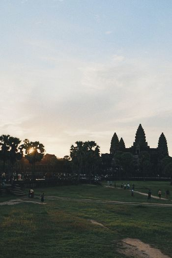 Angkor Wat Beauty In Nature Cambodia Day Field Golf Golf Course Grass Landscape Large Group Of People Leisure Activity Lifestyles Men Nature Outdoors People Playing Playing Field Real People Scenics Sky Sport Sunset Tree